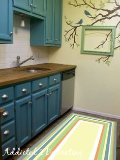 Painted Floor Cloth:: Two Three Of Many Design Options - Addicted 2 Decorating® CHECK OUT THE WALL! Painted Floor Cloth:: Two Three Of Many Design Options Decking on the house the single most remarkab. Kitchen Cabinets Decor, Kitchen Cabinet Doors, Diy Cabinets, Condo Kitchen, Kitchen Ideas, Teal Cabinets, Turquoise Cabinets, Funky Kitchen, Colored Cabinets