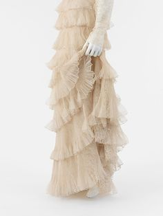Detail...nude tiered lace skirt by Chanel, 1936