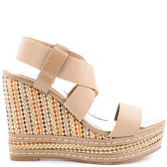 The Terrace will be your new go to summer sandal!  Charles by Charles David introduces this neutral style with elastic fitting straps.  A multi color texture wraps around the 4 1/2 inch wedge and 1 inch platform for the final touch.