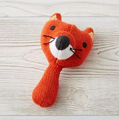 Shop Love Handle Rattle (Fox).  Our animal rattles are made from soft cotton knit and fit perfectly into tiny hands.  Each Love Handle Rattle features a colorful wild animal that your little one will love to handle (see what we did there?).