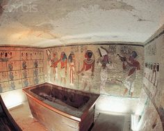 A shot showing three walls of the tomb. At right are the eight mourners, pulling Tut's coffin on a sledge