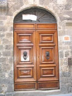 Check out the big door knockers here.  This is also San Gimignano, Italy.
