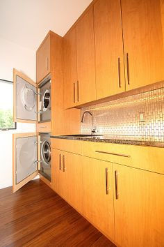 Hide the washer and dryer behind cabinet doors.