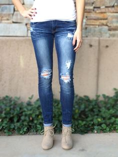 """Low rise skinny leg jeans with slight distressing. Traditional 5 pocket and zip fly zipper closure.  These jeans are the perfect fit and have a stretchy waist which makes it easy to button.   32"""" inseam  97% Cotton 3% Spandex $42 and FREE shipping http://thetickledpinkboutique.net/collections/bottoms/products/machine-distressed-skinnies"""