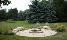 Gut Flagstone Patio With Firepit And Boulder Seating