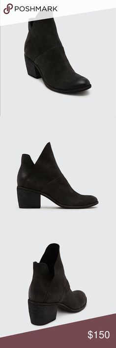 100% Nubuck Slouchy Booties Soft nubuck Dolce Vita booties styled with a slouchy, asymmetrical cuff. Hidden elastic insets secure the layered shaft. Chunky, stacked heel and synthetic sole. Leather: Cowhide. Measurements Heel: 2.25in / 60mm Dolce Vita Shoes Ankle Boots & Booties