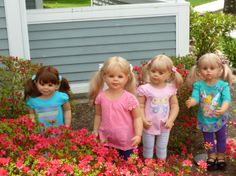 My girls Olivia ,Julie, Skye and Amelia Rose out playing in the yard around the flowers, Jeannie in Howell