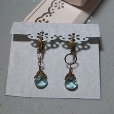 DIY earring/jewelry display cards using cardstock and paper punches from the craft store. Great idea!