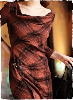 Classic plaid with a twist—a textural French fabric of cotton (99%) with elastane (1%)is artfully pleated to create the sultry, contemporary silhouette. Drapy portrait neckline; ¾-sleeves; faux wrap skirt with toggle.
