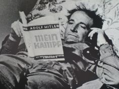 "Oklahoma soldier from the 45th, Sgt. Arthur E. Peters, reclining on Hitler's bed, reading a copy of Mein Kampf.   The picture made it onto the cover of the May 14, 1945 edition of Life magazine, with the caption, ""Get your feet off my bed.""  (The regiment's headquarters was set up in a rather unlikely place:  an apartment where Adolph Hitler had lived.)"