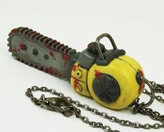 Bloody Chainsaw Necklace in yellow by beatblack on Etsy, $47.00