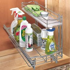 Under the sink storage.  Love how this has 2 different size shelves.
