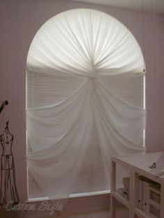 Arch-Window-Curtain The panels are twisted in the center – start with two in the center, twist around each other once, and hook each on side it started from. Then twist outer panels around those and hook them on the sides they started from as well. Of course, you can always drape and twist however you like for all kinds of different looks.
