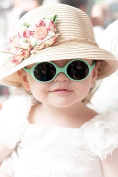 Kiddo in floral straw hat, white dress, and mint green sunglasses. Protecting those itty bitty eyes.