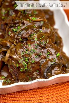 Soft chopped sirloin patties with a savory gravy is a perfect, and ...