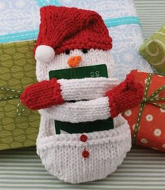 Snow Man Gift Card Cozy | AllFreeKnitting.com This DIY gift card holder will bring a smile to anyone's face. Add some extra holiday cheer to your gift cards with the Snow Man Gift Card Cozy.