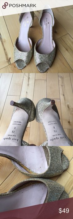 Kate Spade Gold Peep Toe Heel Gorgeous heels. A little wear inside where there is some glitter (could be wiped out) but for the price and fact no one will see that it looks great! The outsides are beautiful kate spade Shoes Heels