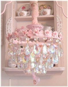 I want a chandelier for my bathroom like this! I love the huge dangling teardrop crystals