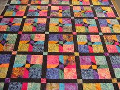 I'm not much for sewing, but this batik quilt is gorgeous!