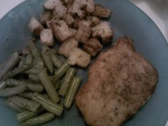 Baked pork chop with the illusion of it being fried...green beans and roasted garlic potatoes