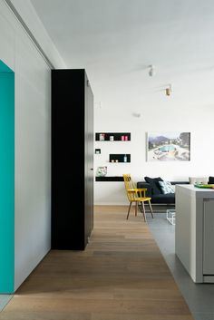 Tiny Tel Aviv Apartment Color play.  Love this unframed doorway/hall treatment.