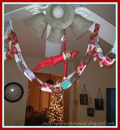 Day #5 (Tues, Dec. 3): Making Life Whimsical: We Believe in Christmas Magic!  Elf makes paper garland...and this will serve as a countdown to Christmas.  We will take off one ring every night.