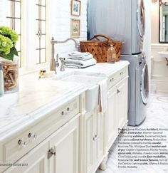 Light and Sophisticated Laundry Room by Jamie MacLean