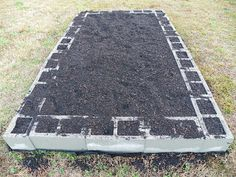 Great idea for a cheap raised vegetable garden! Plant herbs, strawberries or even marigolds in the edge block holes.