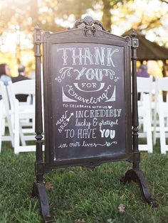 """Announce a heartfelt """"thank you"""" with a DIY hand lettered chalkboard sign to showcase your gratitude to your wedding guests."""