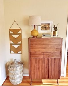 Thanks to @ideasparkinteriors regram for a Warmth + Welcoming Living Room, a simple decor with endearing characters by incorporating Milano #midcentury style #barcabinet highlighted alongside bright, brass accessories- NPD Furniture