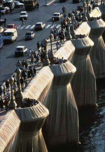 Artists : Christo and Jeanne Claude.   In 1985 they wrapped the Pont Neuf,Paris.