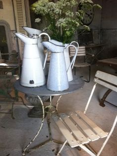 I like the garden table and chair but maybe just one granite/enamel body pitcher with flowers. Cute for a small porch. Flea Market Finds, Flea Markets, Garden Table And Chairs, Porch Decorating, Decorating Ideas, Decor Ideas, Painted Doors, Stone Flooring, Antique Stores