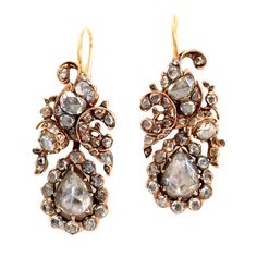 Georgian Rose Cut Diamond Silver Gold Floral Drop Earrings. Original Georgian chandelier earrings in 14k yellow gold with silver overlay feature 6 carats of rose-cut diamonds. Graceful, asymmetrical arabesque design. Rare, special and in extraordinary condition for their age.