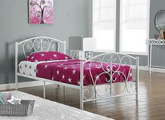 """This white metal twin bed will be a lovely addition to any bedroom. With dainty curves that appeal to the feminine eye, this bed easily blend with any decor. Solidly built with 2"""" metal post legs and sufficient mattress support, this bed does not require a box spring. Headboard, footboard and frame are included."""
