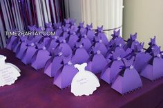 purple bridal shower ideas - Google Search- dollar tree favors with scrap paper