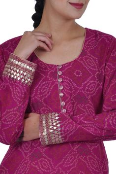 A beautiful magenta bandhani print georgette kurta with gold gota patti embroidery on front hemline and sleeve ends. The shirt neckline is round and inches long front opening with button closures. Salwar Designs, Kurti Neck Designs, Dress Neck Designs, Kurta Designs Women, Designs For Dresses, Blouse Designs, Designer Dress For Men, Indian Designer Suits, Designer Dresses