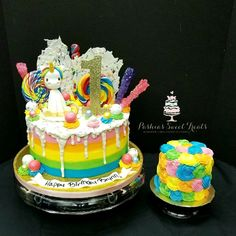 """This cute cake and smash cake was picked up earlier today by a wonderful customer. This is a 9"""" vanilla cake with buttercream icing with white chocolate on top. The unicorn is made out of fondant and gumpaste  and the customer provided the candy we added on top. The smash cake is a lemon 4"""" cake with buttercream icing."""