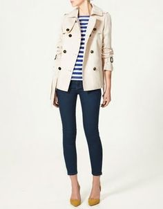 Striped sailor shirt, tan trench, and skinny jeans. Parisian chic