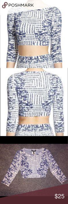 BCBG MAXAZRIA Blue Printed Crop Top BCBG MAXAZRIA 'Miranduh' knit blue printed crop top. 3/4 length sleeves, very fitted. 81% cotton, 17% nylon, 2% spandex. Machine wash cold, gentle cycle. Previously worn. BCBGMaxAzria Tops Crop Tops
