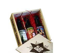 This charming engraved wooden crate contains three bottles labeled with saucy photos that are sure to make him smile. Each hot-but-not-too-fiery variety is made in Napa, California, and contains a different type of chili pepper, including Mexican, Arbol, and Chipotle.