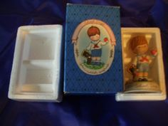 Joan Walsh Anglund Collection School Days Porcelain Boy Figurine by Avon.