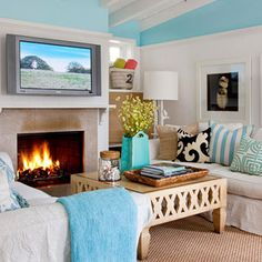Love this cheerful space? Learn how to get the look with the help of a Shop BHG Shopping guide! Browse the products here: http://www.bhg.com/shop/shopping-guide/get-the-look/eclectic-beach-inspired-living-room.html