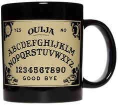 OUIJA BOARD COFFEE MUG - Your morning coffee has never been so spiritual. Start a new ritual each morning with this large 20 oz mug that features the famous Ouija Board.