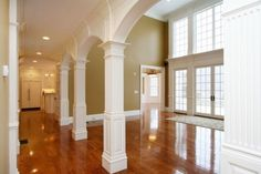 Columns and Archway with Flutes and Raised Panel Detail by Custom Home Finish, MA