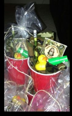Duck dynasty party favors..another idea would be cute if u could find green or blue cups to match Si'S tea glass !!....cute (: