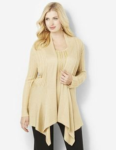 Shimmering with metallic yarn, this cozy cardigan offers glowing style. Ribbed knit fabric keeps you comfortable and gives you a great fit. Complete with a smooth finish that leads to the draping, asymmetrical hem. Comes in your choice of lovely metallic colors. Long-sleeve cardigan matches to our coordinating Shimmerfall Tank for extra shine. Catherines tops are designed for the plus size woman to guarantee a flattering fit. catherines.com