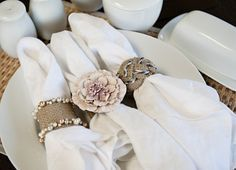 DIY Napkin rings- could make or thinking dollar store flower hair band...buy a bunch glue flower on some fabric and tie...voila!