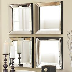 beveled glass mirror.  120 bucks for a set of four.