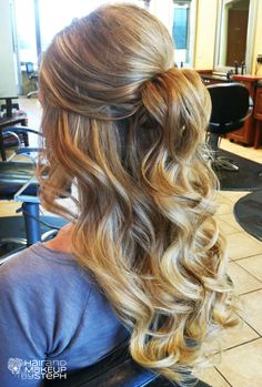 Love the volume in this half up style - almost like a bun that falls into waves at the back