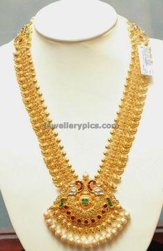 Gold Mango haram with peacock locket - Latest Jewellery Designs